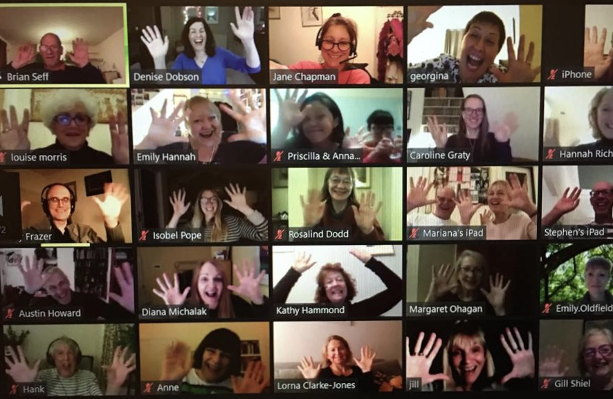 Screenshot showing lots of Songworks choir members waving on Zoom