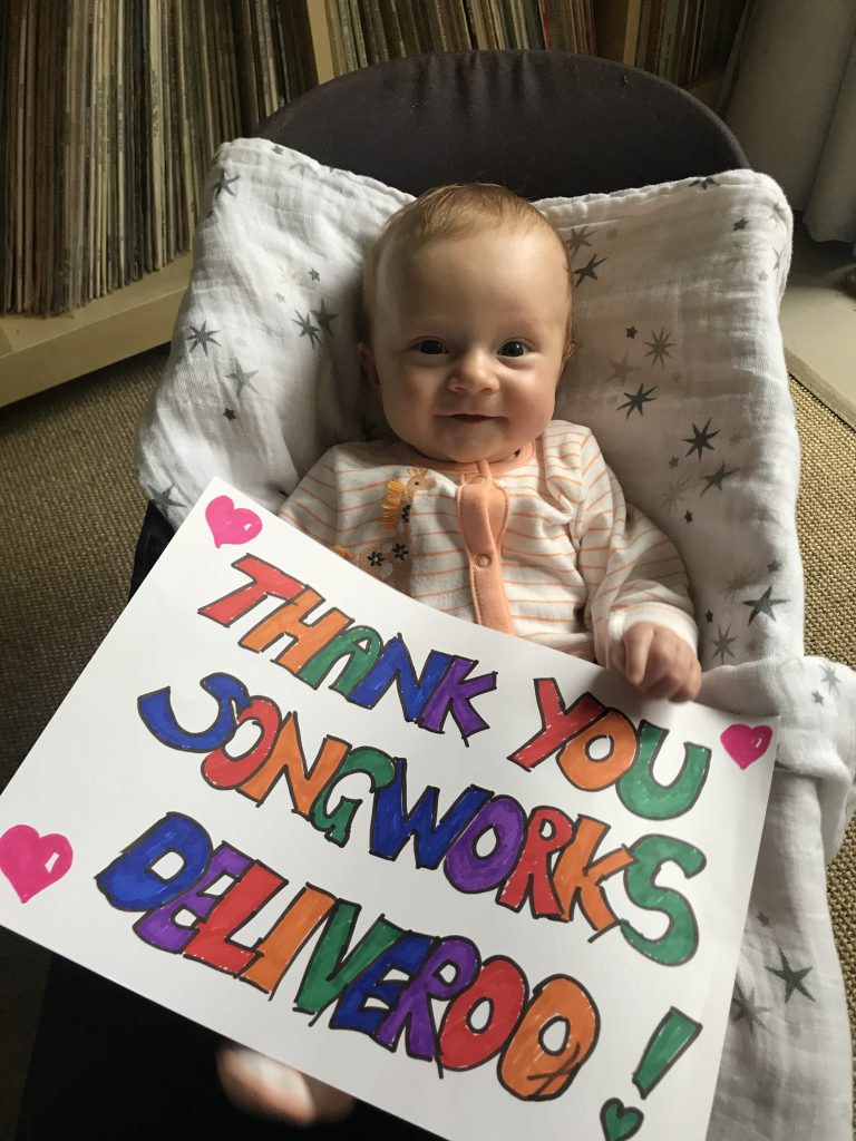 A photo of Florence holding a 'thank you' sign